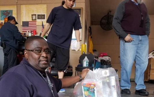 Staff handling toy donations to LA Mission