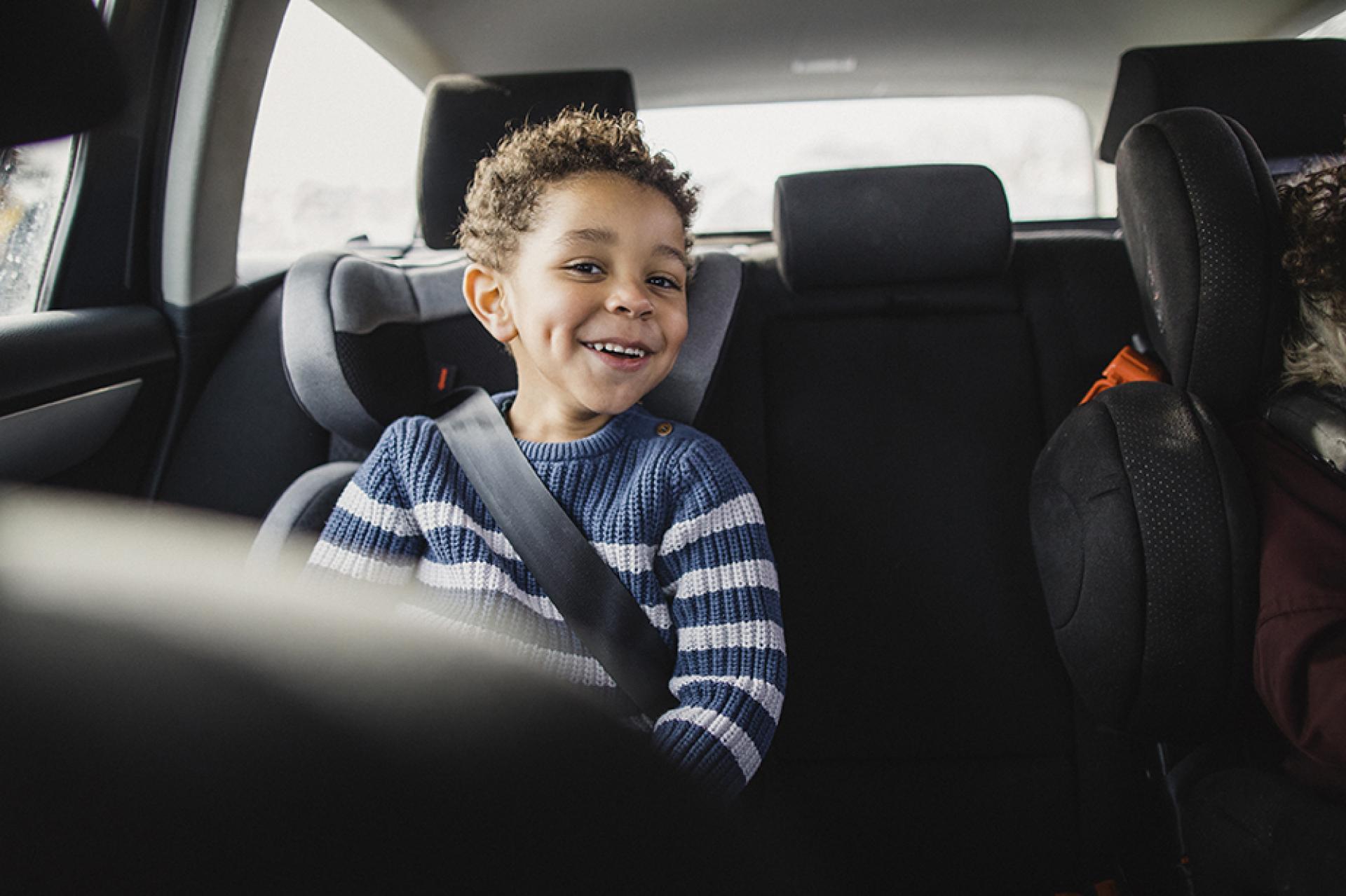 Child in car seat in a car