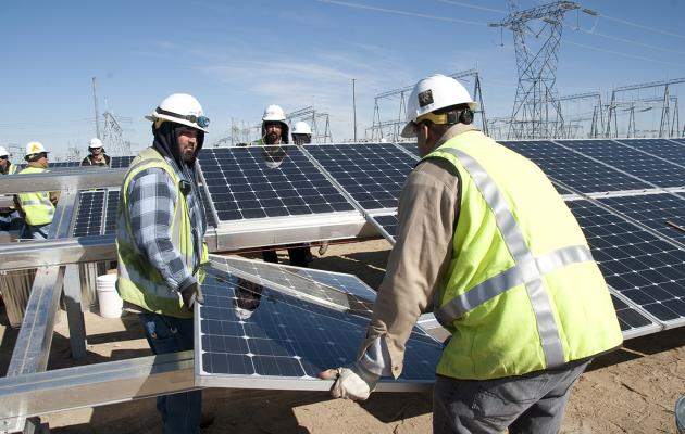 Water and Power workers with solar panels