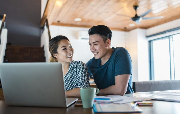Asian Couple Doing Research