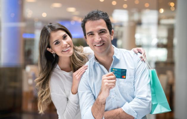 Man and woman holding credit card