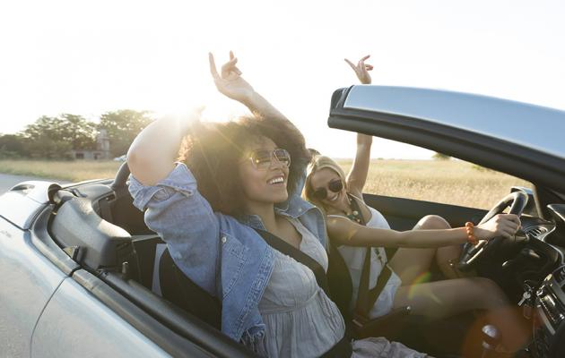 Two women in convertible enjoying the ride