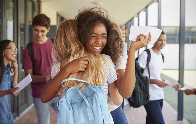 School girls hugging first day of school