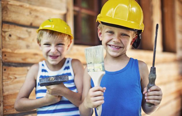 Two boys in hard hats