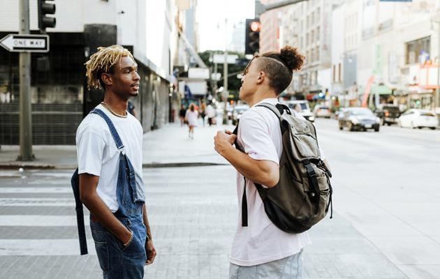 Two men talking on street