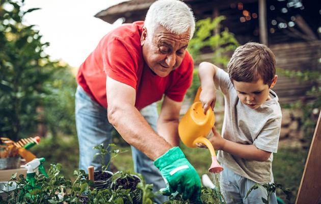 Man and child in garden