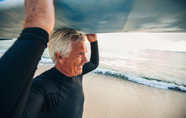 Man walking with surfboard