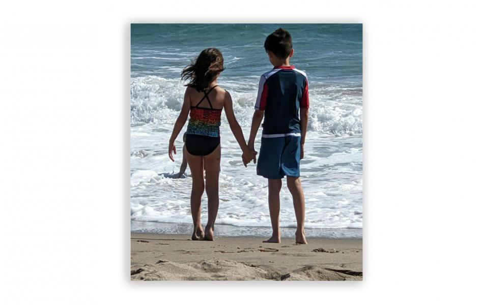A photo of two kids at the beach.