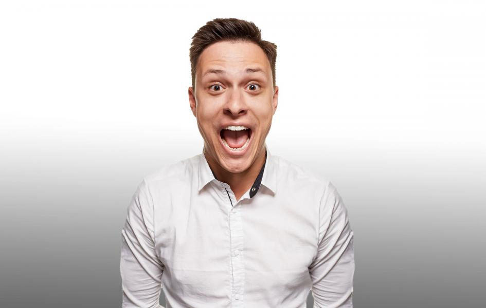 A man looking happy with his mouth opened
