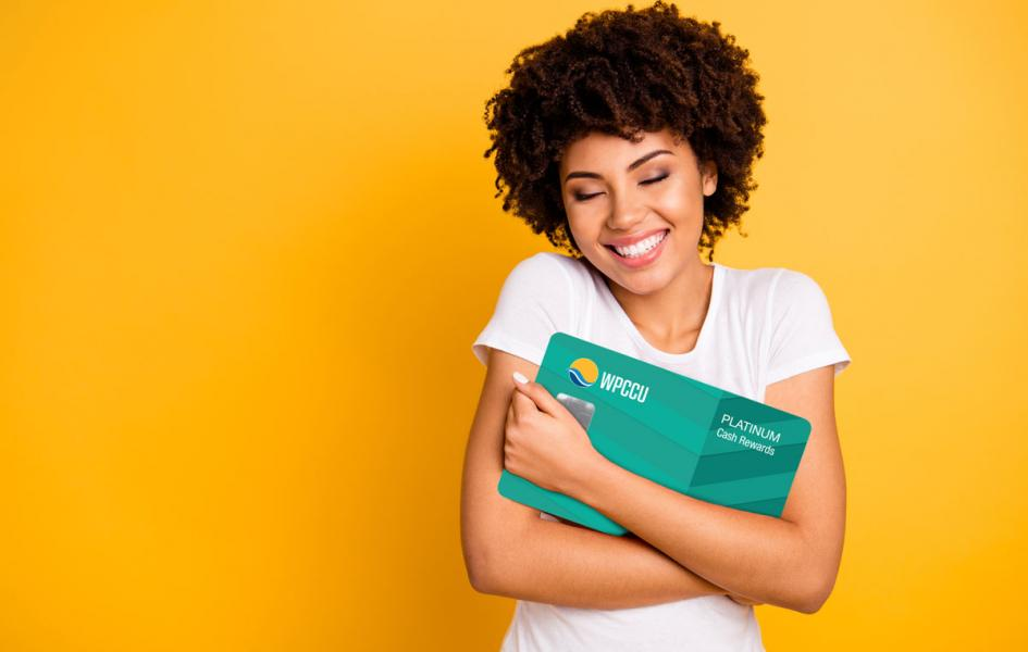A young lady hugging WPCCU Mastercard