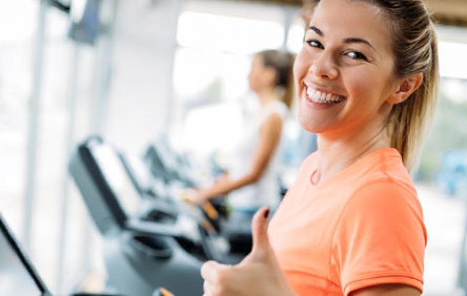 Happy Woman on treadmill.