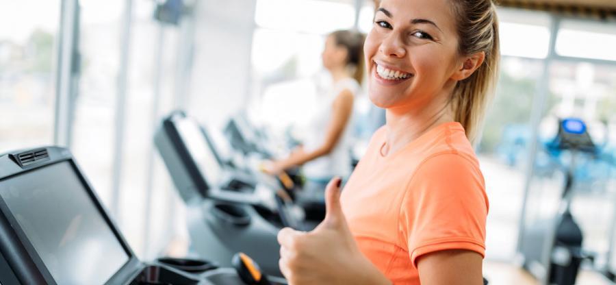 A happy woman on a treadmill.