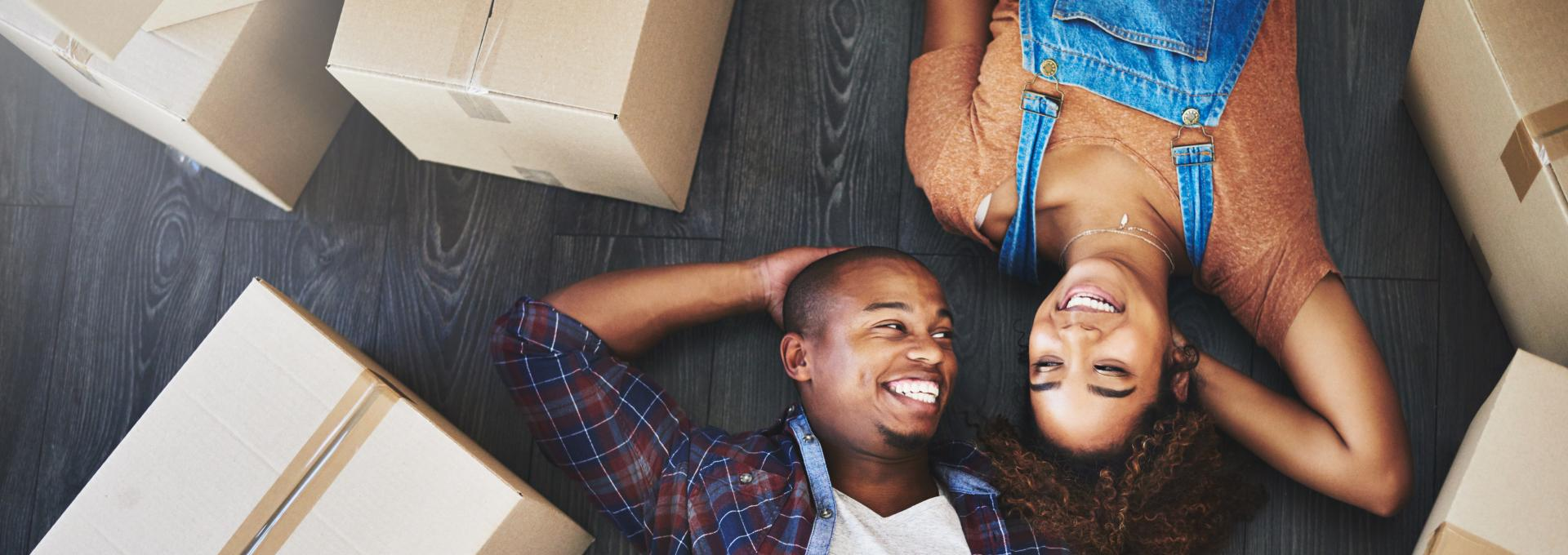 Man and woman laying on floor