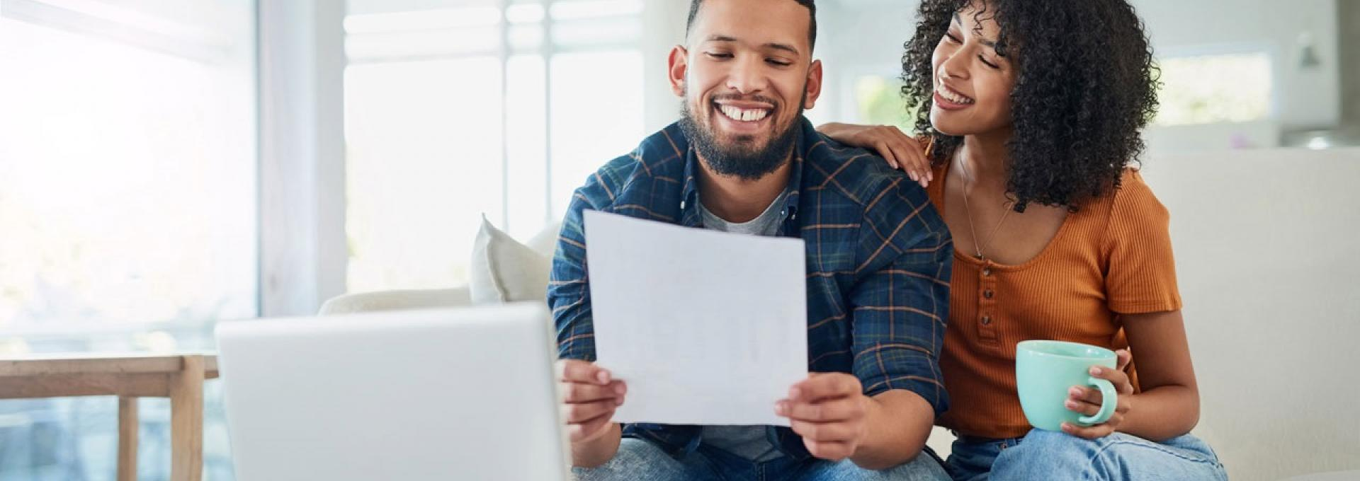 Couple looking at their financing options